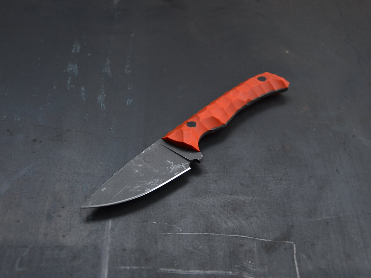 EDC knife with orange G10 handle and stonewash finish